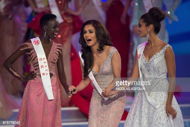 Miss India Manushi Chhilar reacts as she wins the 67th Miss World contest final next to France Aurore Andrée Raphaëlle Kichenin and Miss Kenya...