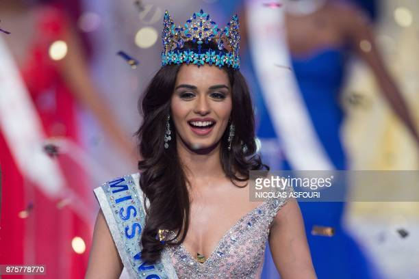 Miss India Manushi Chhilar smiles as she wins the 67th Miss World contest final in Sanya on the tropical Chinese island of Hainan on November 18 2017...