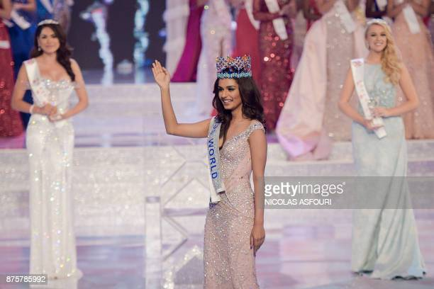 Miss India Manushi Chhilar smiles as she wins the 67th Miss World contest final next to 2nd runner up Miss Mexico Alma Andrea Meza Carmona and 3rd...