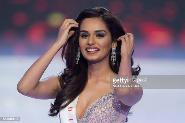 Miss India Manushi Chhilar walks on the stage minutes before winning the 67th Miss World contest final in Sanya on the tropical Chinese island of...