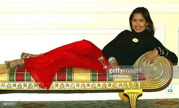 Miss India Shruti Sharma poses for photos at Miss World press conference December 5 2002 in London The Miss World competition was moved from its...