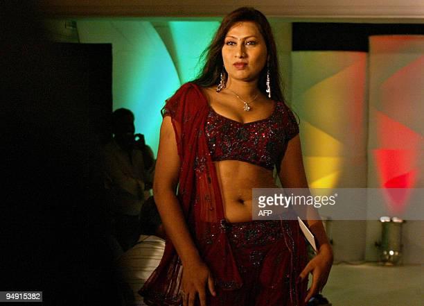 Miss India Transgender winner Karina Shalini walks the ramp during the pageant in Chennai on December 19 2009 More than 100 hopefuls walked the ramp...