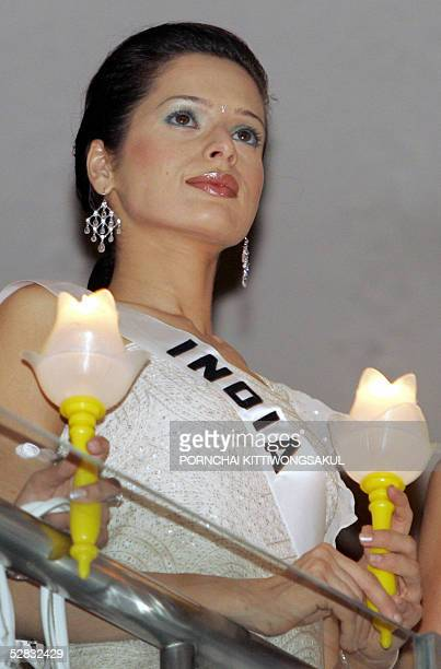 Miss India Universe 2005 Amrita Thapar holds a candle during a function for AIDS victims in Bangkok 16 May 2005 The 54th annual Miss Universe contest...