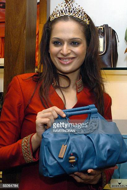 Miss IndiaUniverse 2005 Amrita Thapar poses with a bag from the new 'Riviera' collection from Hidesigns in New Delhi 21 July 2005 Hidesign products...