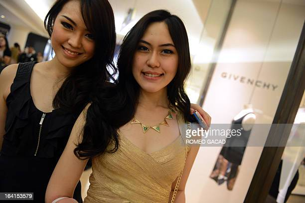 Miss Indonesia 2013 Vania Larissa and Miss Maluku Marsha Pical arrive to a lavish party and fashion show hosted by an Indonesian high society...