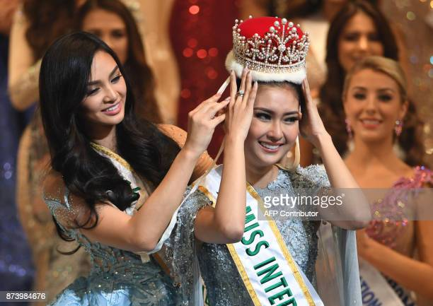 Miss Indonesia Kevin Lilliana receives the 2017 Miss International crown from 2016 Miss Internatinal Kylie Verzosa from Philippines during the Miss...
