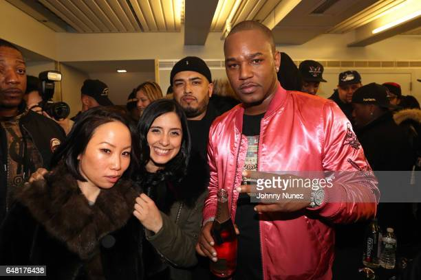 Miss Info Laura Stylez DJ Juanyto and Cam'ron backstage at The Apollo Theater on March 4 2017 in New York City