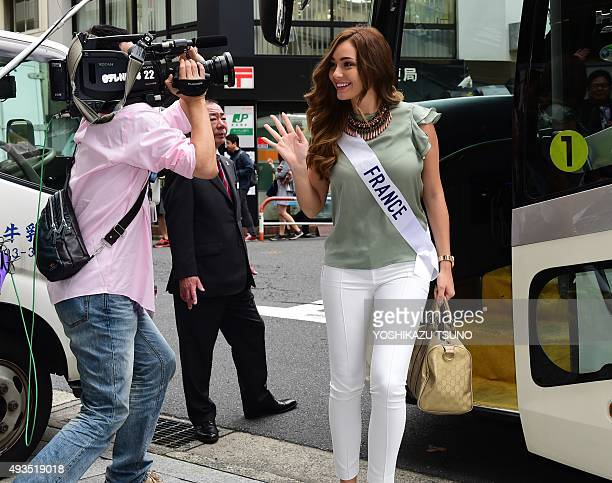 Miss International contestant Miss France Charlotte Pirroni smiles upon her arrival at Tokyo's Isetan department store for shopping on October 21...