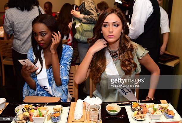 Miss International contestants Miss France Charlotte Pirroni and Miss Haiti Marie Viannye Manard enjoy lunch at Tokyo's Isetan department store on...