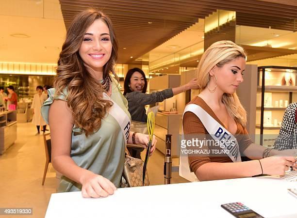 Miss International contestants Miss France Charlotte Pirroni and Miss Belgium Elda Nushi shop at Tokyo's Isetan department store on October 21 2015...