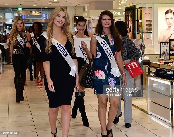 Miss International contestants Miss Sweden Isabella Jedler Forsman and Miss Sri Lanka Angela Jayatissa smile upon their arrival at Tokyo's Isetan...
