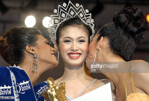Miss International Queen 2004 Thai transvestite Treechada Petcharat is kissed by first runner up Arisha Rani from India and second runner up Filipino...