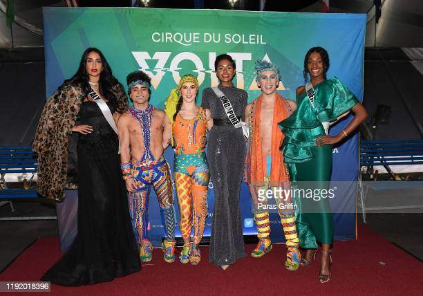 Miss Italy Sofia Marilù Trimarco Miss Singapore Mohanaprabha Selvam and Miss Nigeria Olutosin Araromi pose with cast members of Volta during Volta By...