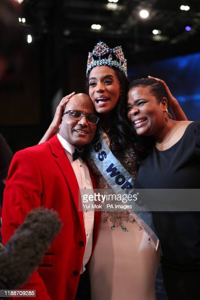 Miss Jamaica 2019 ToniAnn embraces her parents Bradshaw Singh and Jahrine Bailey after she is announced Miss World 2019 during the 69th Miss World...