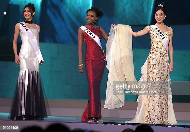 Miss Japan Mina Chiba Miss Kenya Julie Njerustand And Miss Korea MinKyoung Kim Stand On Stage During The Preliminary Gown Event In The Miss Universe...