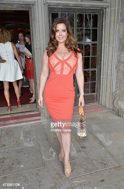 Miss June 1997 Carrie Stevens attends Playboy's 2015 Playmate of the Year Ceremony at the Playboy Mansion on May 14 2015 in Los Angeles California
