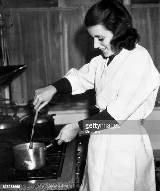 Miss Kathleen Kennedy is shown here cooking on a stove top