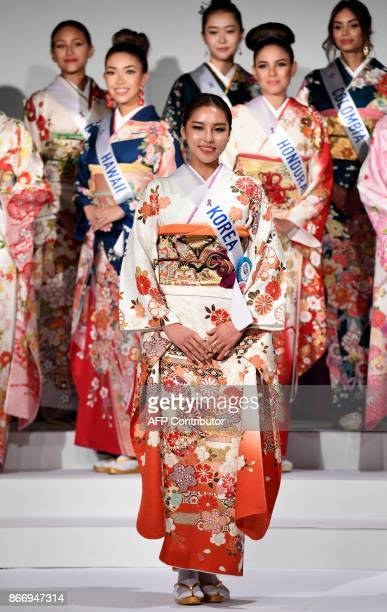 Miss Korea Nam SeungWoo poses in traditional Japanese Kimono during the 57th Miss International Beauty Pageant press conference in Tokyo on October...