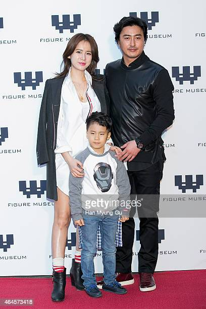 Miss Korea Re HyeWon and Ahn JungHwan attends the photo call for the opening of 'Figure Museum W' on February 26 2015 in Seoul South Korea