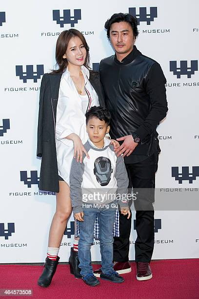 Miss Korea Re HyeWon and Ahn JungHwan attends the photo call for the opening of Figure Museum W on February 26 2015 in Seoul South Korea