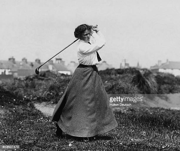 Miss Kyle tees off at a golf course in Portrush