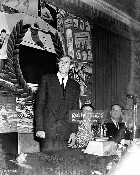 Miss L Mary Barker editor of Pears' Cyclopedia looks on as Roger Bannister gives his acceptance speech after being presented with the Silver Pears...