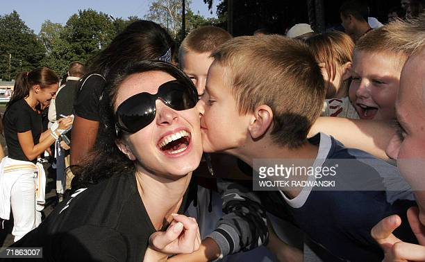 Miss Lebanon Annabella Hilal recives a kiss from a Polish boy after the Sport competition in Mazurian lakes region city of Gizycko 12 September 2006...