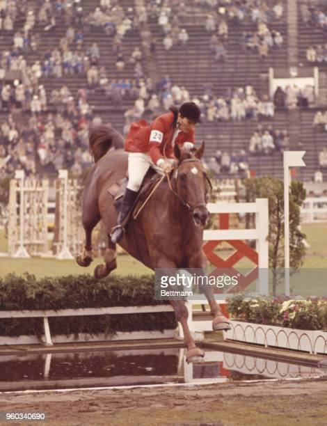 Miss Lefevre of France takes a jump during the Grand Prix of the equestrian events.