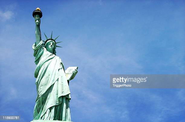 miss liberty on blue - 4th stock pictures, royalty-free photos & images