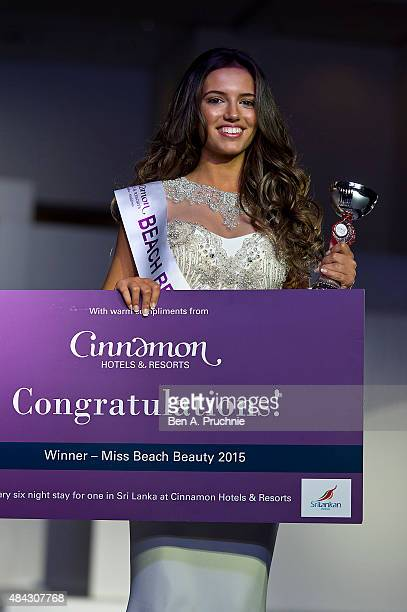 Miss Liverpool Jennifer McSween walks the runway during the finals of Miss England 2015 at The Ricoh Arena on August 14 2015 in Coventry England
