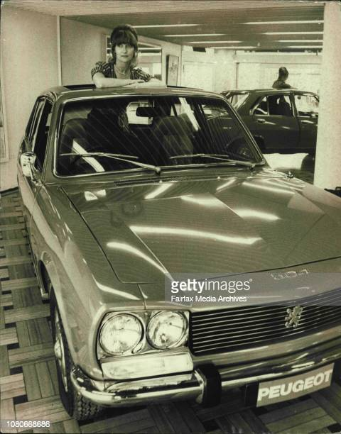 Miss Lorayne Dudding of Centennial Park pictured with the special luxury model of the Peugeot 504 LTI announced at Renault Pty Ltd showrooms in...