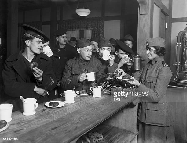 Miss M Diamond serving doughnuts to American servicemen in a Salvation Army hut on Union Square New York circa 1918