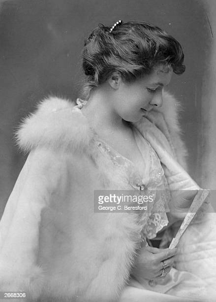 Miss M S Gore wearing a white outfit with a fur trimmed cape