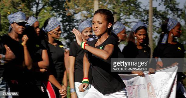 Miss Martinique Stephanie Florence Colosse runs during Miss Sports competition as Miss World contestants from Africa stand in the background in...