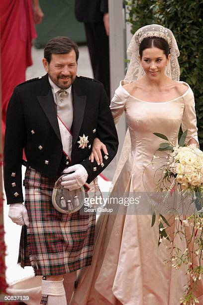 Miss Mary Elizabeth Donaldson walk down the isle with her father Dr John Donaldson moments before marrying Crown Prince Frederik at the Copenhagen...