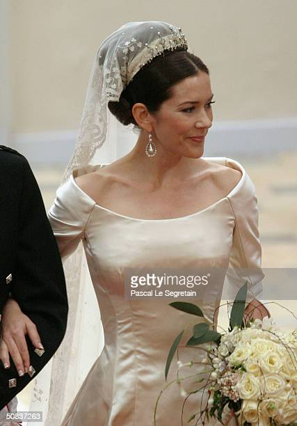 Miss Mary Elizabeth Donaldson walks down the isle with her father Dr John Donaldson moments before marrying Crown Prince Frederik at the Copenhagen...