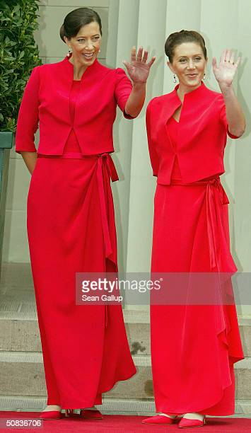 Miss Mary Elizabeth Donaldson's bridesmaids Jane Alison Stephens and Patricia Anne Bailey wait for their sister to arrive at Copenhagen Cathedral on...