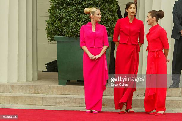 Miss Mary Elizabeth Donaldson's bridesmaids sisters Jane Alison Stephens Patricia Anne Bailey and friend Amber Petty wait for Donaldson to arrive at...