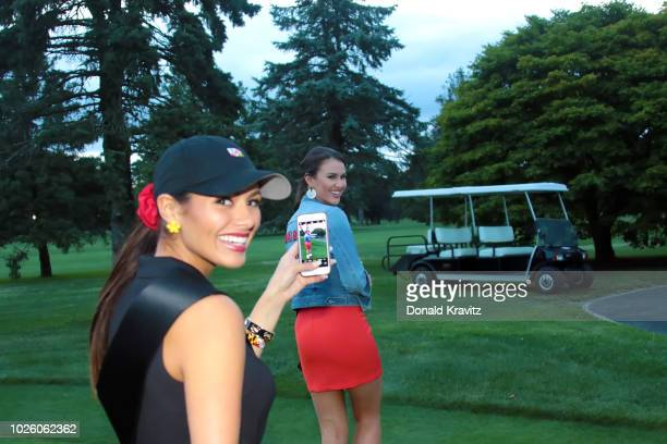 Miss Maryland 2018 Adrianna David takes a photo of Miss Texas 2018 Madison Fuller on the putting green during The Miss America Candidates Golf Outing...