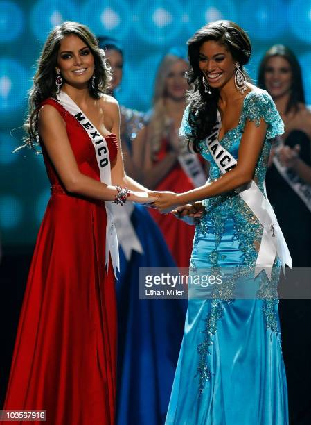 Miss Mexico 2010 Jimena Navarrete and Miss Jamaica 2010 Yendi Phillipps hold hands as they wait for the judges' final decision in the 2010 Miss...