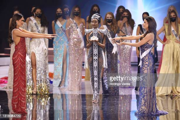 Miss Mexico Andrea Meza, Miss Universe 2019 Zozibini Tunzi and Miss Universe Brazil Julia Gama appears onstage at the 69th Miss Universe competition...