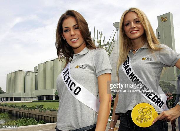 Miss Mexico Laura Elizondo Erhard walks with Miss Serbia & Montenegro Jelena Mandic while visiting the Singha Beer factory during a Miss Universe...