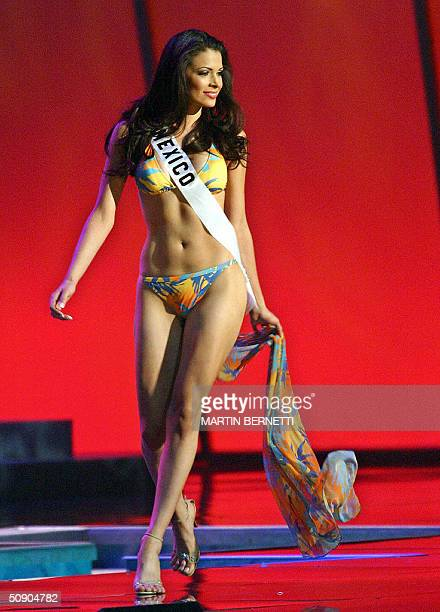 Miss Mexico Rosalva Luna walks on the stage in swimming suite during the first official presentation with the panel of judges in Quito 27 May 2004...