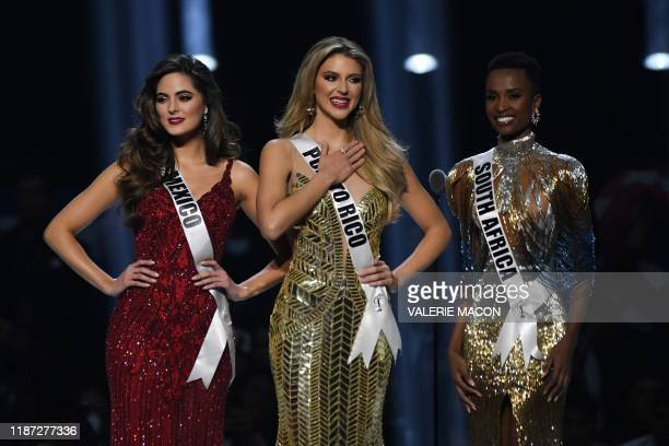 Miss Mexico Sofia Aragon, Miss Puerto Rico Madison Anderson and Miss South Africa Zozibini Tunzi stand on stage during the 2019 Miss Universe pageant...