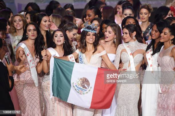 Miss Mexico Vanessa Ponce de Leon dances with the Mexican flag as she celebrates with fellow contestants after she was crowned the winner of the 68th...