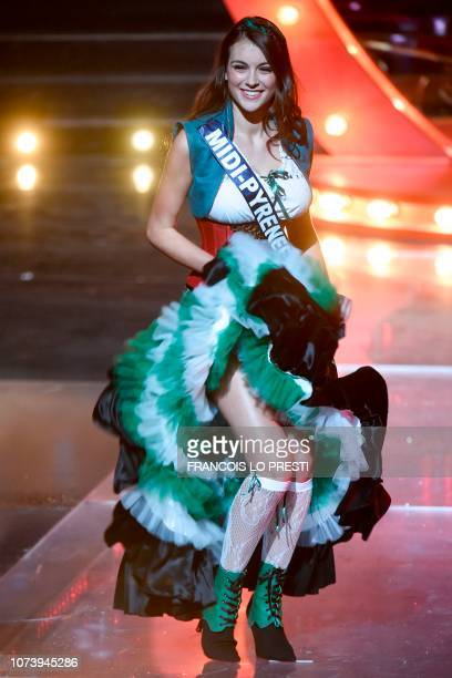 Miss MidiPyrenees Axelle Breil poses on stage during the Miss France 2019 beauty contest in Lille on December 15 2018