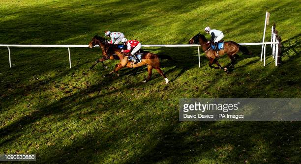 Miss Miggins ridden by David Noonan leads Longhousesignora ridden by Charlie Deutch in the Join Racing TV Now Mares' Handicap Hurdle at Ludlow...