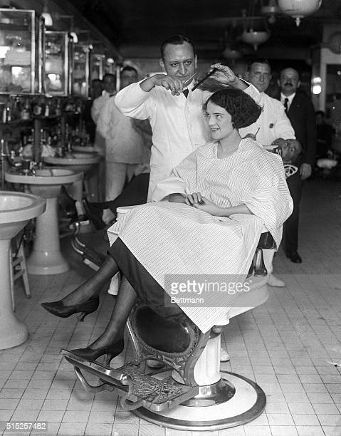 Miss Muriel Redd of Chicago appearing in show 'Tickle Me' having her hair bobbed by Lewis Morgan manager at the Hotel McAlpin barber shop