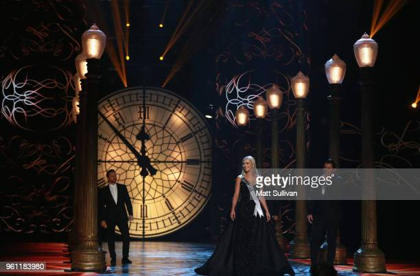 Miss Nebraska Sarah Rose Summers competes in the evening gown portion of the 2018 Miss USA Competition as performers Jeff Timmons Drew Lachey Nick...