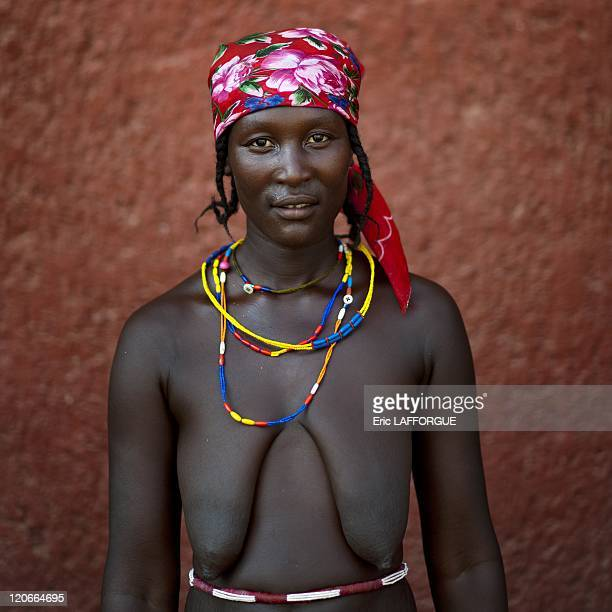 Miss Ness A Refugee Of The Angolan Civil War Opuwo Namibia Woman who is a refugee from Angolan Civil War They surviving by begging and posing topless...
